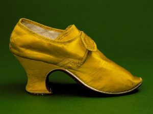 A yellow silk heel from England, circa 1760-1765, with a 'Louis' heel, named for the style worn at the court of Louis XIV.(Wikimedia Commons)