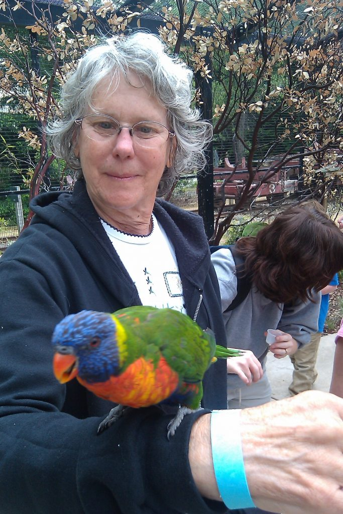 Sandy Yearwood holding a parrot