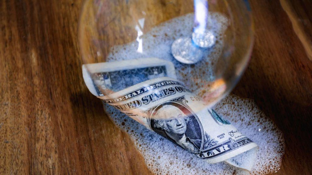 wet soapy dollar bill in a bubble