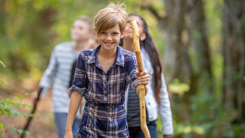 children hiking with hiking sticks